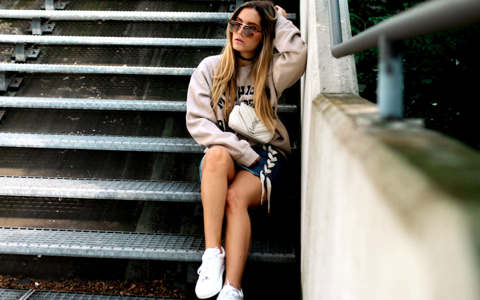 https://www.fashiontwinstinct.com/wp-content/uploads/2017/06/college-sweater-missguided-lace-up-skirt-nubikk-sneakers-ysl-bag-saint-laurent-monogramme-bag-1-960x600_c.jpg