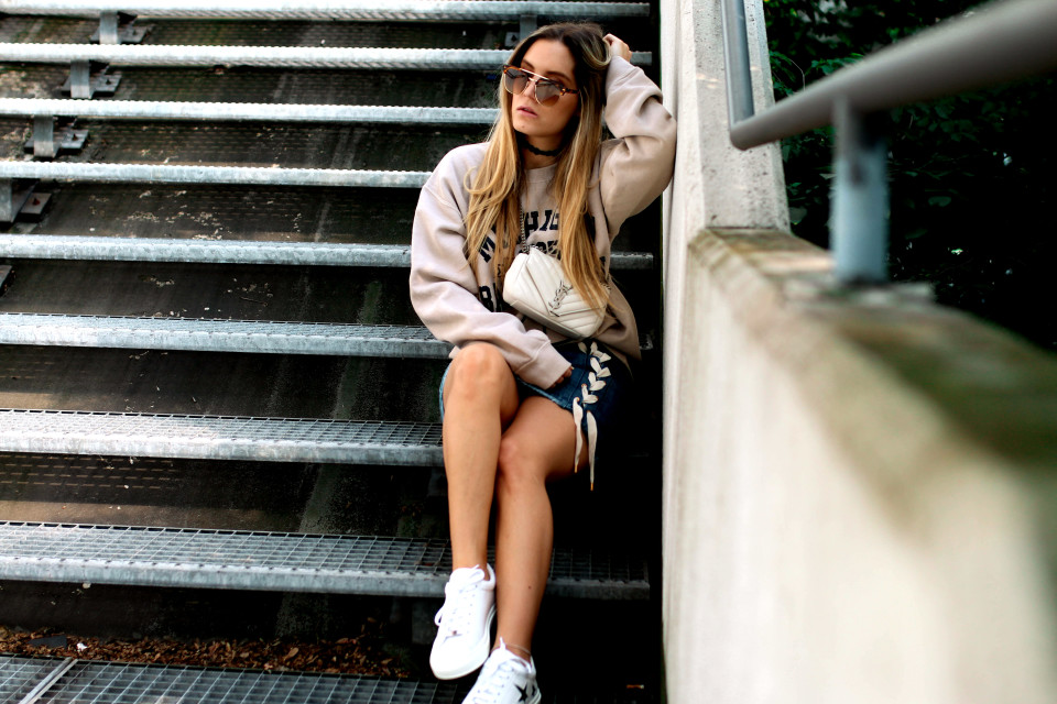 https://www.fashiontwinstinct.com/wp-content/uploads/2017/06/college-sweater-missguided-lace-up-skirt-nubikk-sneakers-ysl-bag-saint-laurent-monogramme-bag-1-960x640_c.jpg
