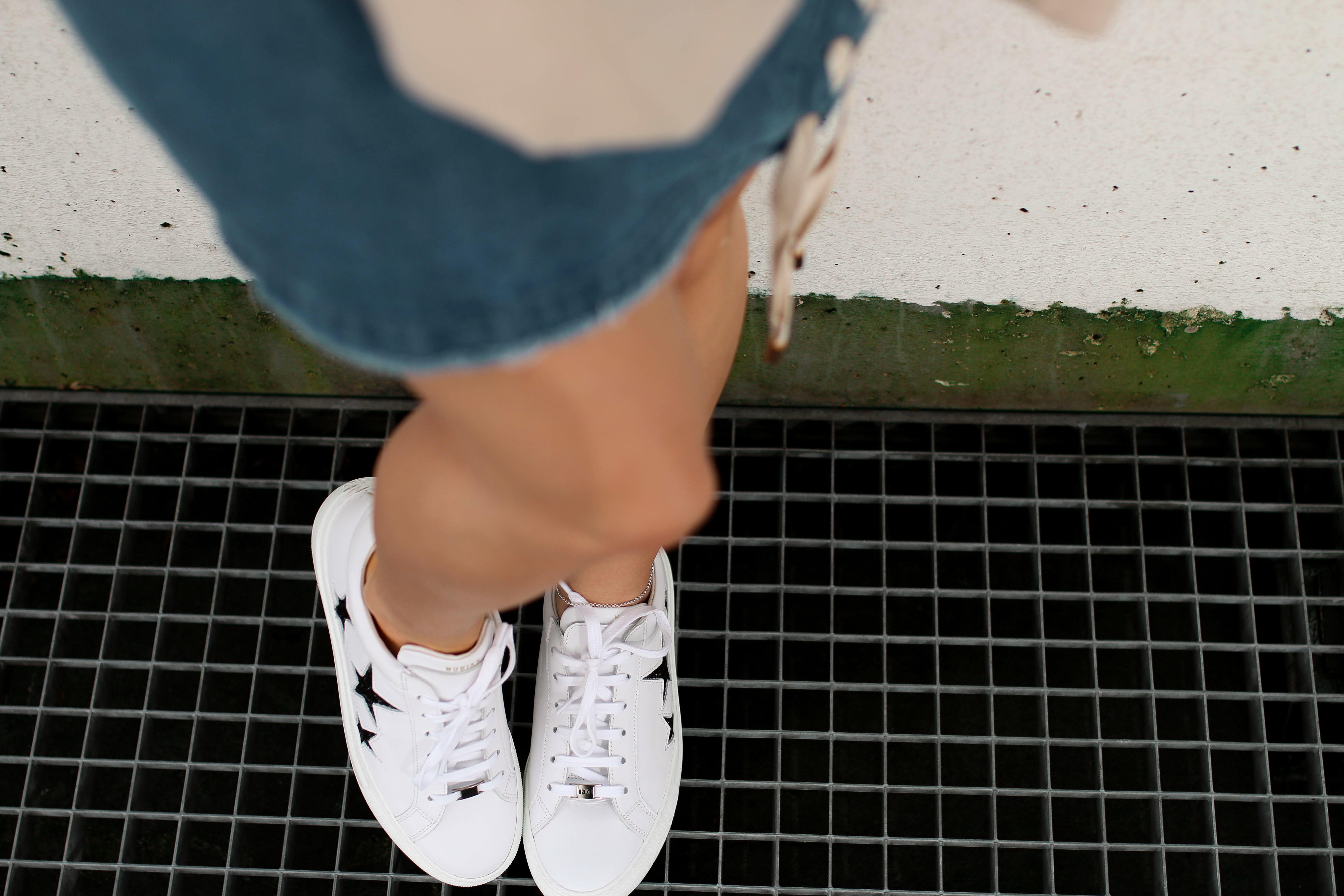 fashion blog college sweater denim skirt nubikk stars sneakers ysl bag