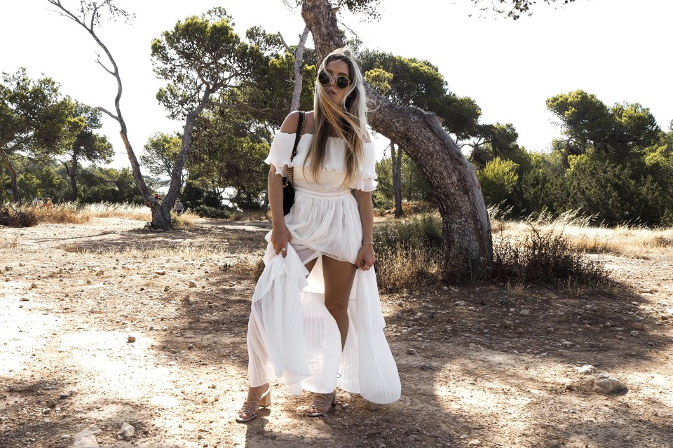 https://www.fashiontwinstinct.com/wp-content/uploads/2017/07/white-summer-dress-maxidress-storets-dress-gucci-marmont-photoshoot-sa-caleta-ibiza-fashionblog-1-960x639_c.jpg